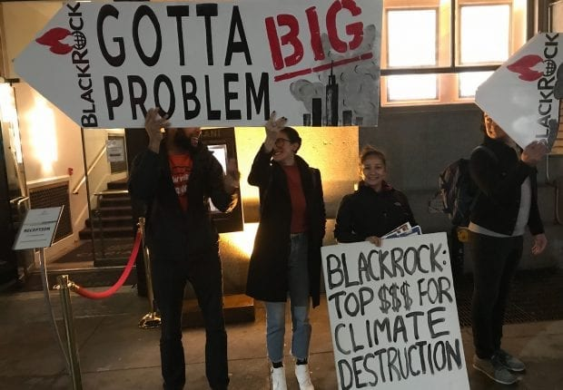 Activists outside an event, following BlackRock CEO Larry Fink