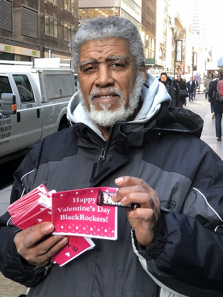 Activist hands out special valentines to BlackRock employees.