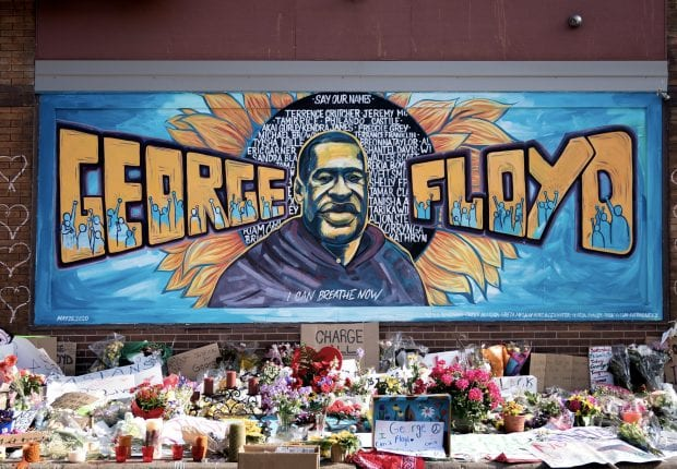Mural and flowers honoring George Floyd