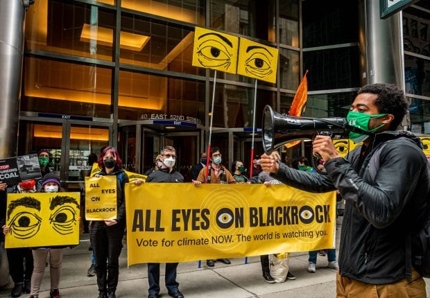 Activists hold All Eyes On BlackRock banner outside BlackRock headquarters